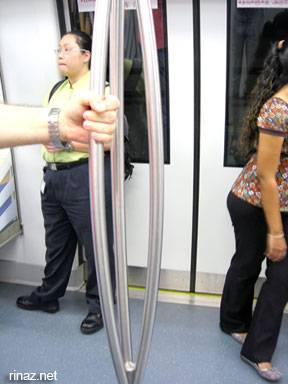 Tri-pole in a train in Singapore