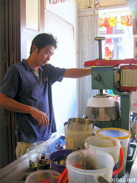 Man making a cold dessert - cendol