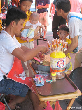 Man handmaking a sweet