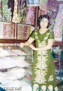 Mum next to the cloth display at Pulau Tekong in the 70s before it was taken over by the military