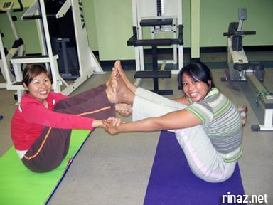 Katherine and Marina does yoga