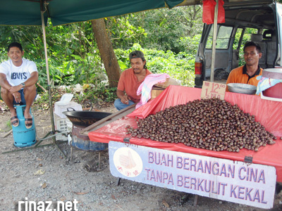 guys selling roasted chestnuts
