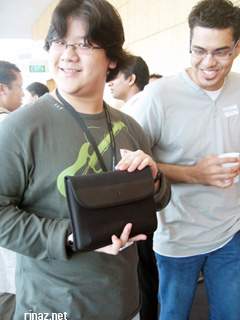 Farinelli holding the eee pc proudly while NTT looks in jealously