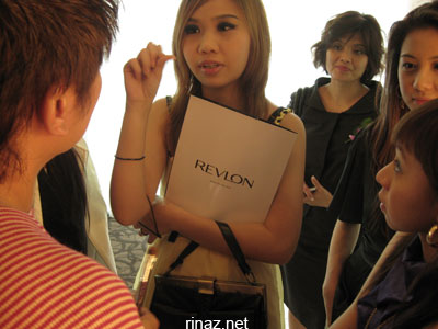 Bloggers surround the makeup artist at the Revlon Launch