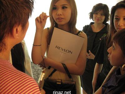 Bloggers surround the makeup artist at the Revlon Launch