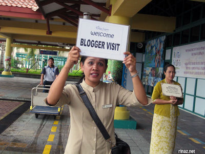 Woman carrying blogger placard