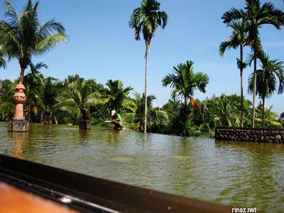 Man on a steep pond at Bintan lagoon Resort