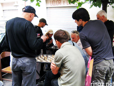 Men playing checkers - rinaz.net